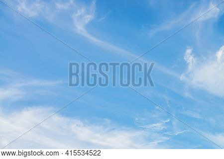 Scenic Nature Landscape With Beautiful Cirrus Clouds In Blue Sky. Colorful Cloudscape With Spindrift
