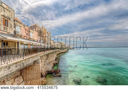 Syracuse Sicily/ Italy -april 11 2020: The Alfeo Seafront Seen From The Sea