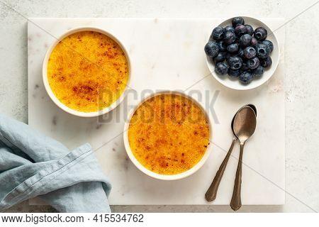 Two Ramekin With Creme Brulee. Traditional French Vanilla Cream Dessert. Spanish Crema Catalana, Ric