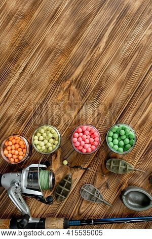Accessories For Carp Fishing And Fishing Baits On Wooden Planks With Copy Space