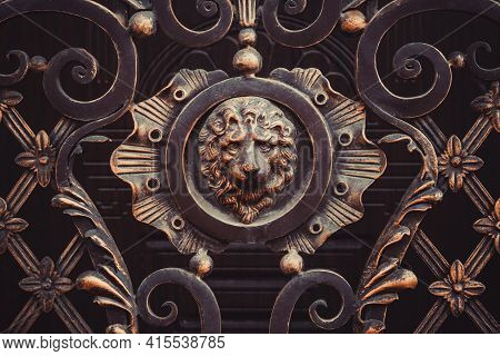Forged Ornate Gate Details With Lion Head Cast Iron Sculpture, Bronze Colored, Rosette Style. Metal