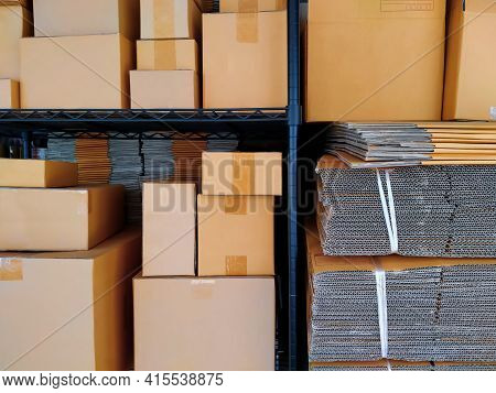 Various Sizes Of Many Carton Boxes With Stack Of Folding Cardboard Boxes On Shelf For Sale At Store