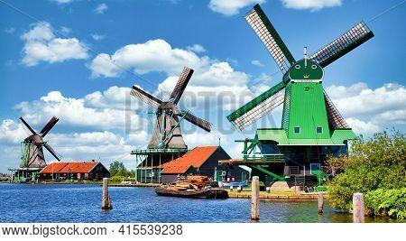 Zaanse Schans, Netherlands - Circa August 2020: Dutch Windmill In Green Countryside Close To Amsterd