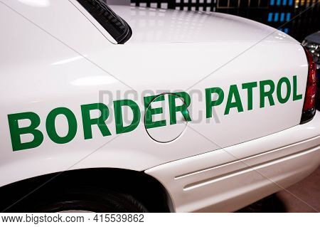 Customs And Border Patrol Logo On The Side Of The Patrol Car