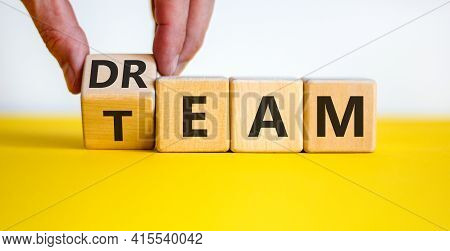 Dream Team Symbol. Businessman Turns The Cube And Changes The Word 'dream' To 'team'. Beautiful Yell