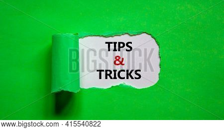 Tips And Tricks Symbol. Words 'tips And Tricks' Appearing Behind Torn Green Paper. Beautiful Green B