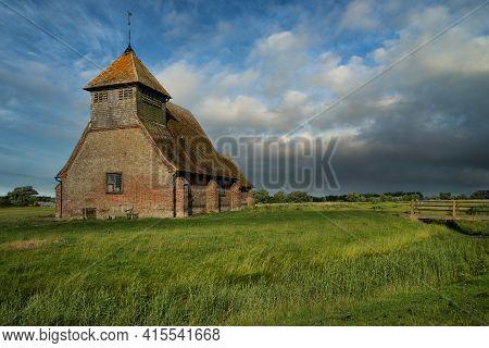 Ancient Medieval Church Landscape Against Summer Sky