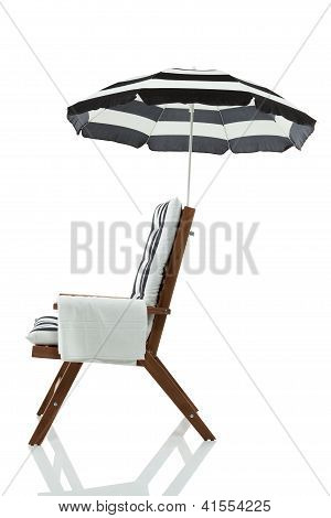 Beach chair with umbrella and towel