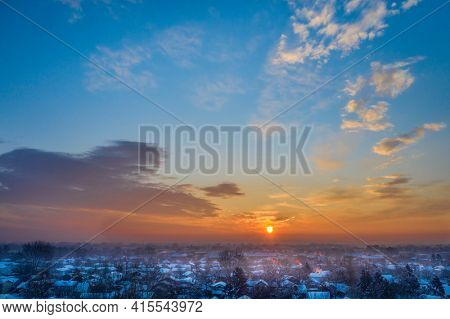 sunrise over city of Fort Collins after heavy snowstorm, aerial view of late winter or early spring scenery
