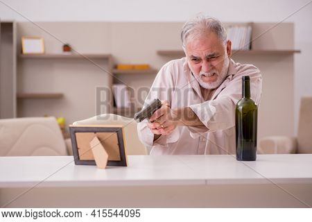 Old male alcoholic widower committing suicide at home