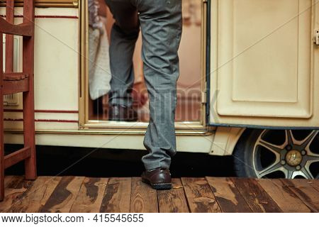 Elderly Man In Jeans Going Inside His Motorhome