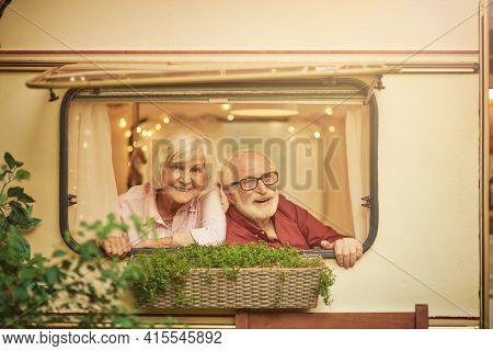 Smiling Senior Spouses Having A Fun Journey On Their Motorhome