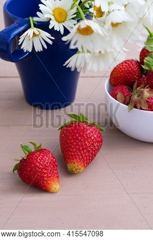 Two Appetizing Ripe Strawberries On Strong Sunlight With Long Shadows On Grunge Wooden Background Wi