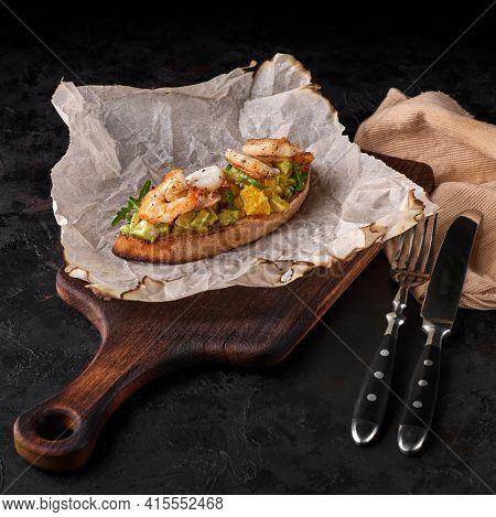 Appetizer Of Bread With Shrimp, Avocado And Citrus Bruschetta. Crostini. Bruschetta. Sandwich. Antip