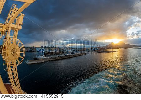 Naples, Italy - March 23, 2021: Sunrise On Mount Vesuvius Seen From A Ship In The Port Of The Gulf O