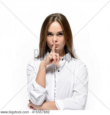 Attractive Young Woman Making Silence Sign Over White Background. Silence, Secret And Quiet Concept
