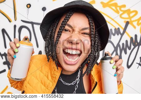 Close Up Shot Of Emotional Teenage Girl Exclaims Loudly Shows White Teeth Uses Aerosol Sprays For Dr