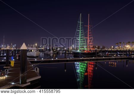1st December 2020.dubai Creek Harbor Skyline With Boats And Ships Illuminated In Flag Colours For Th