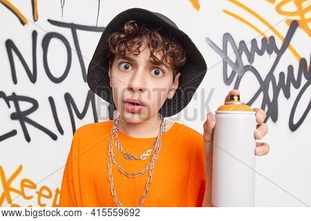 Surprised Teen Guy Looks Shocked At Camera Holds Aerosol Bottle Spray Enjoys Creating Contemporary A