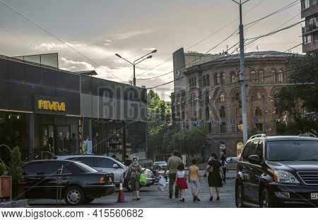 Yerevan,armenia,may 28,2020:evening City Of Yerevan With The Last Passersby With Purchases In Protec