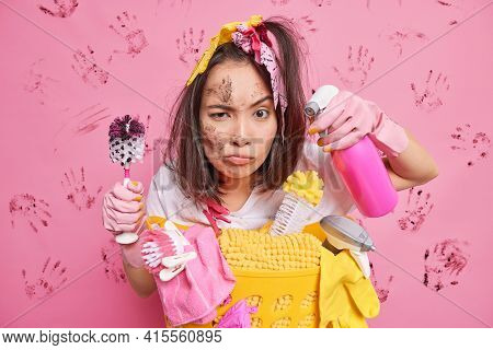 Sanitary Hygiene And Housecleaning Concept. Busy Housewife Focused With Attentive Look At Camera Hol