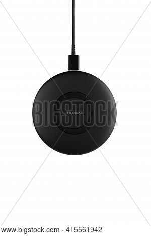Wireless Charging For A Smartphone On A White Background. Fast Wireless Charger Close-up.top View.