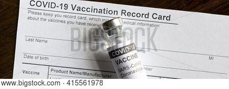 Covid-19 Vaccine Bottle On Coronavirus Vaccination Record Card, Panoramic Banner With Corona Virus V