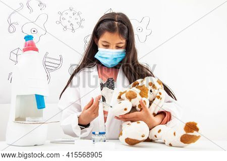 Young Girl Vaccinating. Young Girl Playing A Life Sciences Professional Role. Could Be Biologist, Do