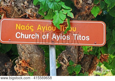 Street Sign Near August 25th Street For The Church Of Ayios Titos In Heraklion, Crete, Greece.