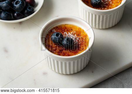 Creme Brulee In Little Ramekin. Close Up French Vanilla Cream Dessert. Burned Cream, Burnt Or Trinit