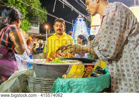 Howrah, West Bengal, India - April 14th 2019 : Street Vendor Serving Chotpoti , A Roadside Indian Be