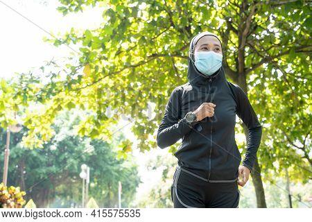 Muslim Sport Woman Wear Mask Running Outdoor In The Park