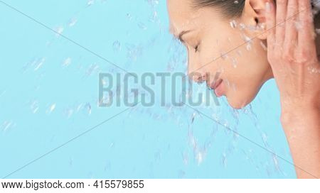 Woman washing her clean face with water. Closeup face of an Young  girl washing face with water.   Skin care hygiene procedure.