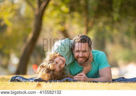Childhood And Parenthood Kids Concept. Happy Father And Son Playing Together Outdoor. Children Love