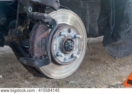 Old Brake Pads On Disc Brake With Removed Brake Calipers Of The Vehicle. Car Brake Repairing.