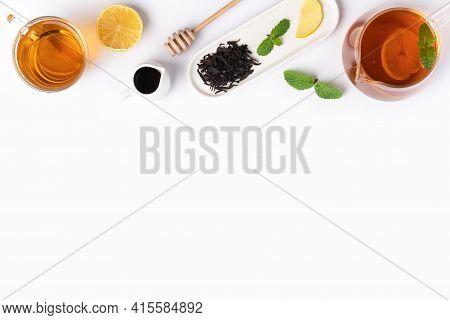 Design Concept Top View Of Honey Black Tea With Lemon And Mint.