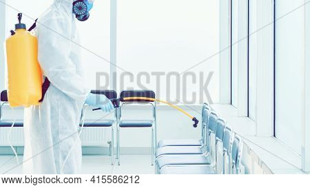 Man In A Protective Suit Disinfects Indoor Accommodation.