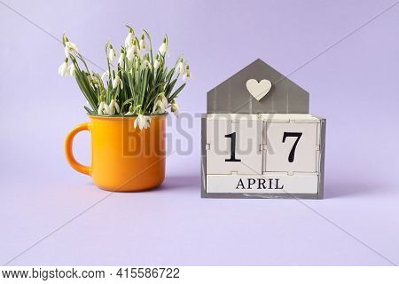 Calendar For April 17: Cubes With The Number 17, The Name Of The Month Of April In English, A Bouque