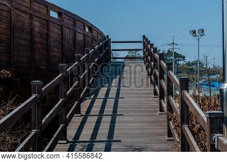 Wooden Boardwalk Entrance Way To Replica 14th Century Korean Sailing Vessel Panokseon In Park At Mar