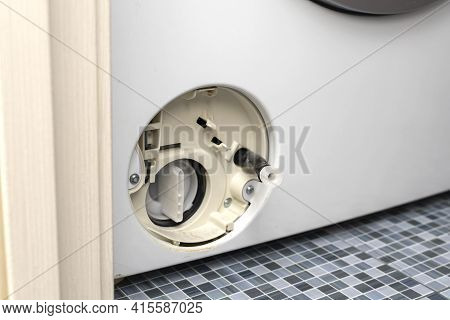 The Filter Of The Washing Machine Is Clogged. Open Filter Cover Of Washing Machine. Problem With Lau