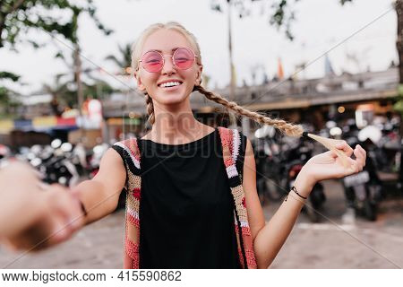 Happy Caucasian Girl With Long Blonde Braids Expressing True Positive Emotions. Outdoor Shot Of Love