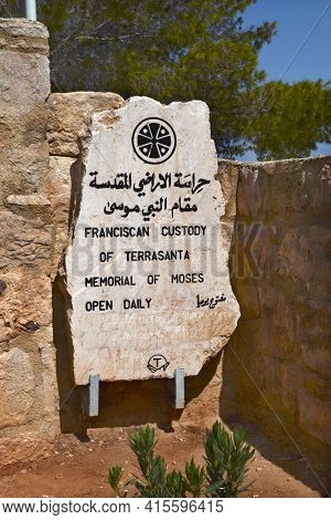 MOUNT NEBO, JORDAN - JULY 22, 2015: Sign for the Memorial of Moses on Mount Nebo. A Christian Holy Place, thought to be the place Moses was given a view of the Promised Land.