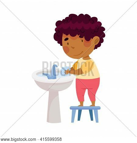 Cute African American Boy Standing On Stool Near Wash Stand Washing His Hands With Soap Engaged In P