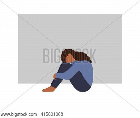 Sad And Depressed African Woman Sitting On The Floor And Hugging Her Knees. Depressed Teenager. Sad