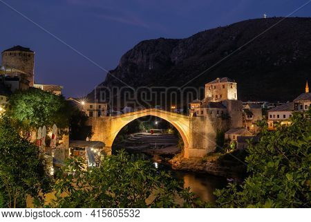 Stari Most bridge at night in old town of Mostar, Bosnia and Herzegovina. Mostar cityscape at summer