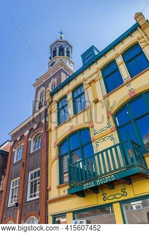 Kampen, Netherlands - April 22, 2020: Colorful Old Houses In Front Of The Tower Of Kampen, Netherlan