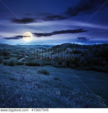 Carpathian Countryside In Spring At Night. Beautiful Rural Landscape In Mountain. Wet Grassy Meadow