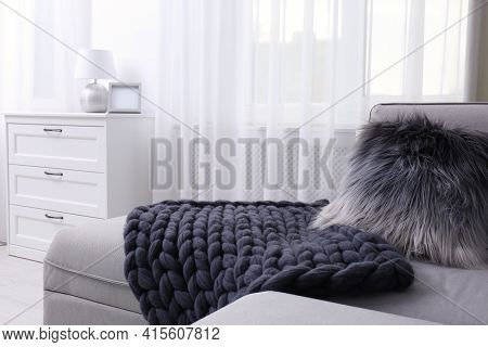 Knitted Merino Wool Blanket On Sofa In Room. Interior Design