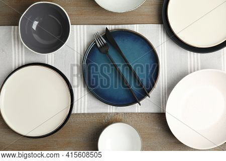 Set Of Clean Dishware On Wooden Table, Flat Lay