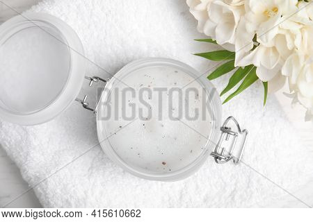 Jar Of Natural Exfoliating Salt Scrub, White Towel And Freesia Flowers On Table, Flat Lay